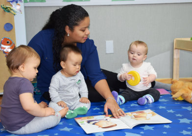 teacher with three babies
